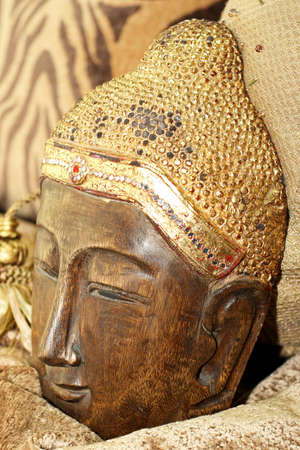 gold top: Buddhism mask made from wood with gold top Stock Photo