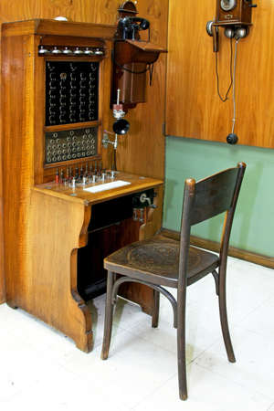 telephonist: Vintage style telephonist workplace with communication desk Stock Photo