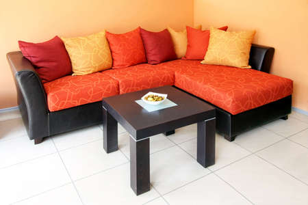 sitting area: Corner sitting area with bunch of pillows Stock Photo