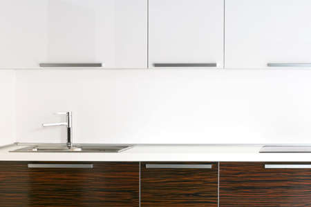 countertop: Bright kitchen counter top with wooden details