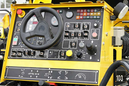 Heavy construction industry cockpit with wheel and buttons Stock Photo - 3712170