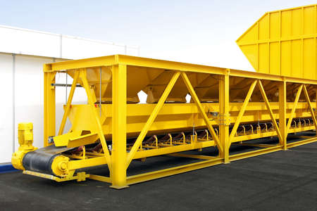 conveyer: Big yellow industry plant with conveyer belt