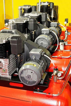 compressor: Several red powerful air compressors in line