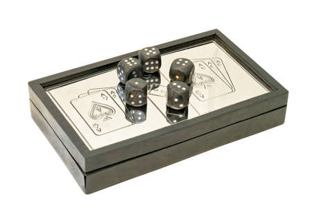 Box of playing cards and dices isolated with clipping path photo