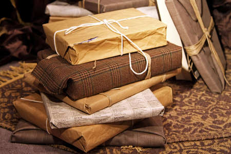 Big pile of gifts wrapped in recycled paper Stock Photo