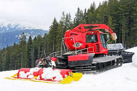 Big snow groomer equipment in snowy mountain photo