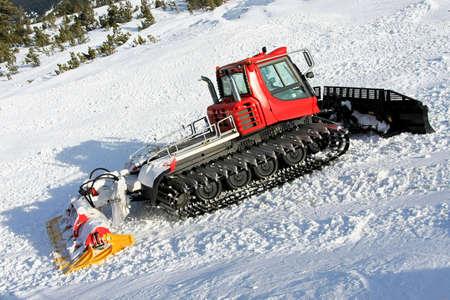 groomer: Big snow groomer equipment in snowy mountain Stock Photo