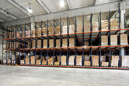 Big shelf with lot of pallets in warehouse Stock Photo