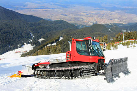 snow grooming machine: Big snow groomer equipment in snowy mountain Stock Photo