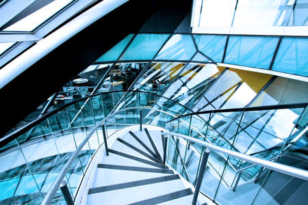 elliptical: Elliptical downstairs way in glass office building Stock Photo