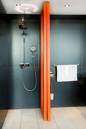 wash basin: Shower all in black with orange divider Stock Photo