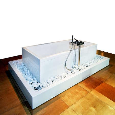 Rectangular bathtub in bathroom with wooden floor photo