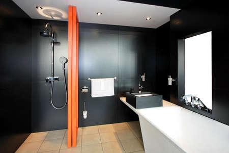 Bathroom all in black with orange divider