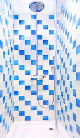 Interior of shower with blue and white tiles Stock Photo - 4303450