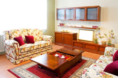 Interior of living room with floral sofa Stock Photo - 4324981