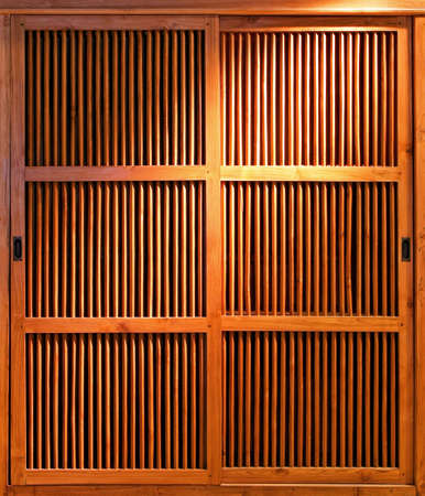 closet door: Close up shot of sliding wooden door