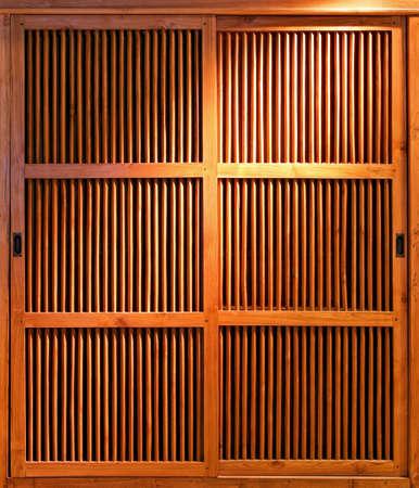 Close up shot of sliding wooden door