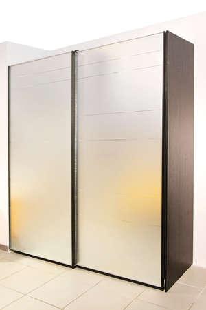Interior of bedroom with big silver locker photo
