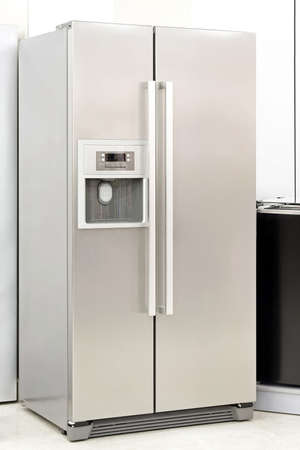 appliance: Silver fridge with double doors an ice maker Stock Photo