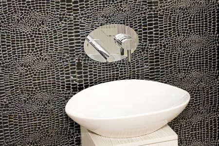 Modern oval bathroom sink and black tiles Stock Photo - 4432278