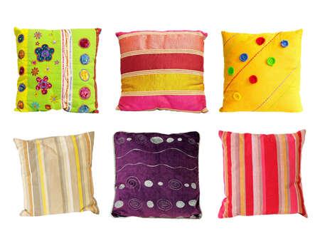 Seis almohadas de colores decorativos aislados en blanco Foto de archivo