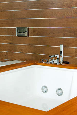 Big modern spa with wooden background wall photo