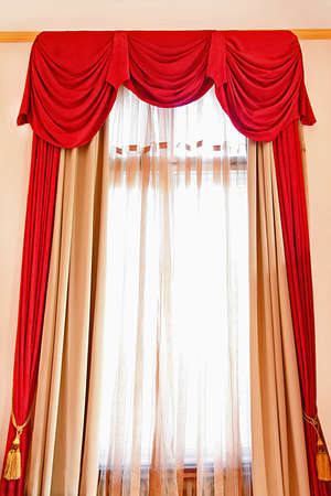 curtain window: Red long drapery at big bright window