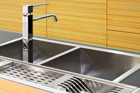 Close up shot of square kitchen sink Stock Photo