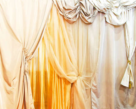 Bunch of different decorative curtains at window  Stock Photo
