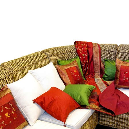 settee: Close up shot of rattan settee with pillows