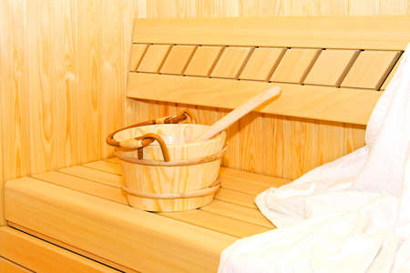 vapour: Wooden bucket in hot steam sauna cabin  Stock Photo