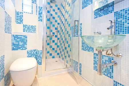 washroom: Interior shot of modern and new blue lavatory Stock Photo