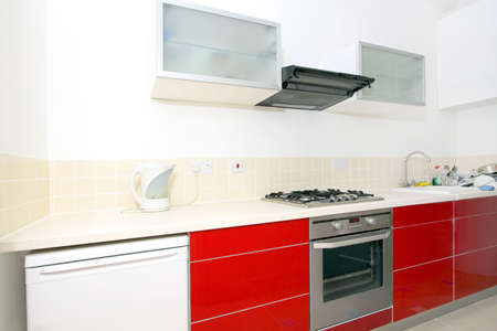 Interior of modern kitchen with red counter  photo