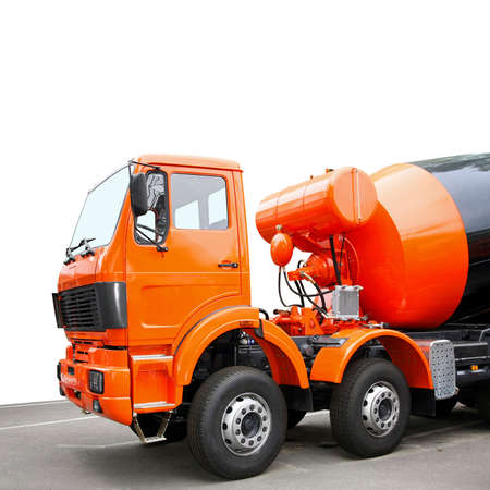 Front view of orange cement mixer truck photo
