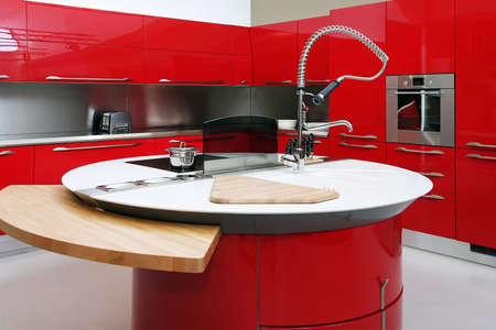 Interior shot of big modern red kitchen photo