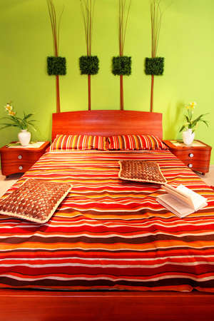 Interior of green bedroom with big bed Stock Photo - 4887908