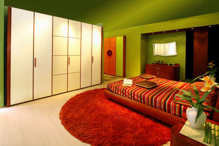Interior of green bedroom with modern furniture photo