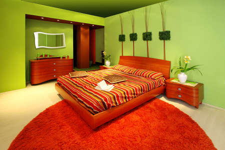 Interior of green bedroom with big bed Stock Photo