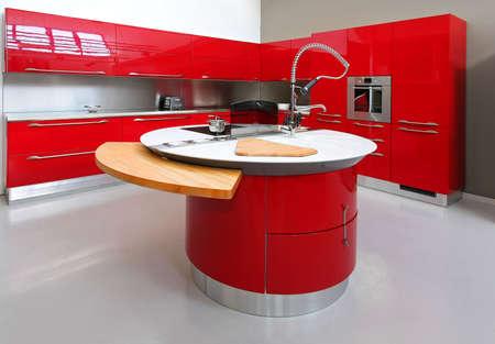 kitchen counter: Interior shot of big modern red kitchen