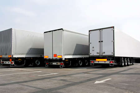Three lorries of semi truck at parking Stock Photo - 5130472