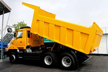 dumper truck: Yellow tipper dump truck for construction work