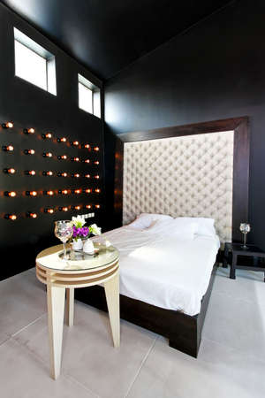 upholster: Interior of dark style bedroom with upholster wall