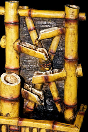 bamboo fountain: Close up shot of old bamboo fountain