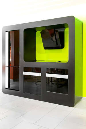 Modern kitchen appliances in black over green wall photo