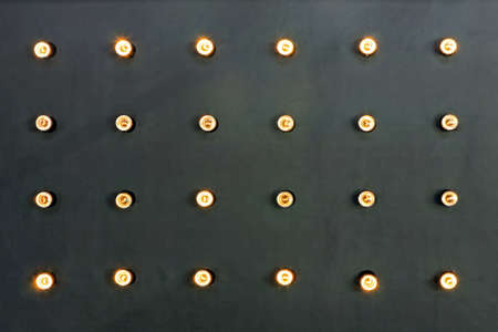 reflectors: Black wall with bunch tungsten lamp reflectors Stock Photo