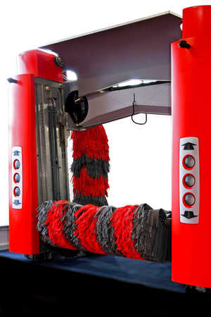 automatic: Automatic red car wash machine with rubber brush  Stock Photo