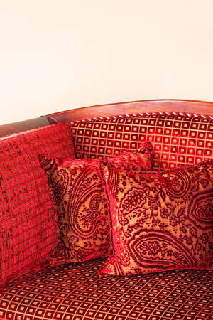 upholster: Close up shot of red pillows and upholster
