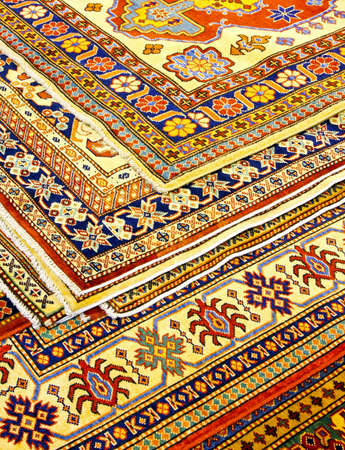 Bunch of colorful Persian carpets and rugs  photo