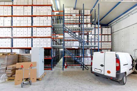 Transport vehicle in big storage house depot  photo