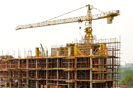 Concrete building construction structure with tall crane Stock Photo - 5400407
